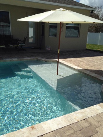 11 cool water features for you to choose from bobco pools for Pool design with sun shelf